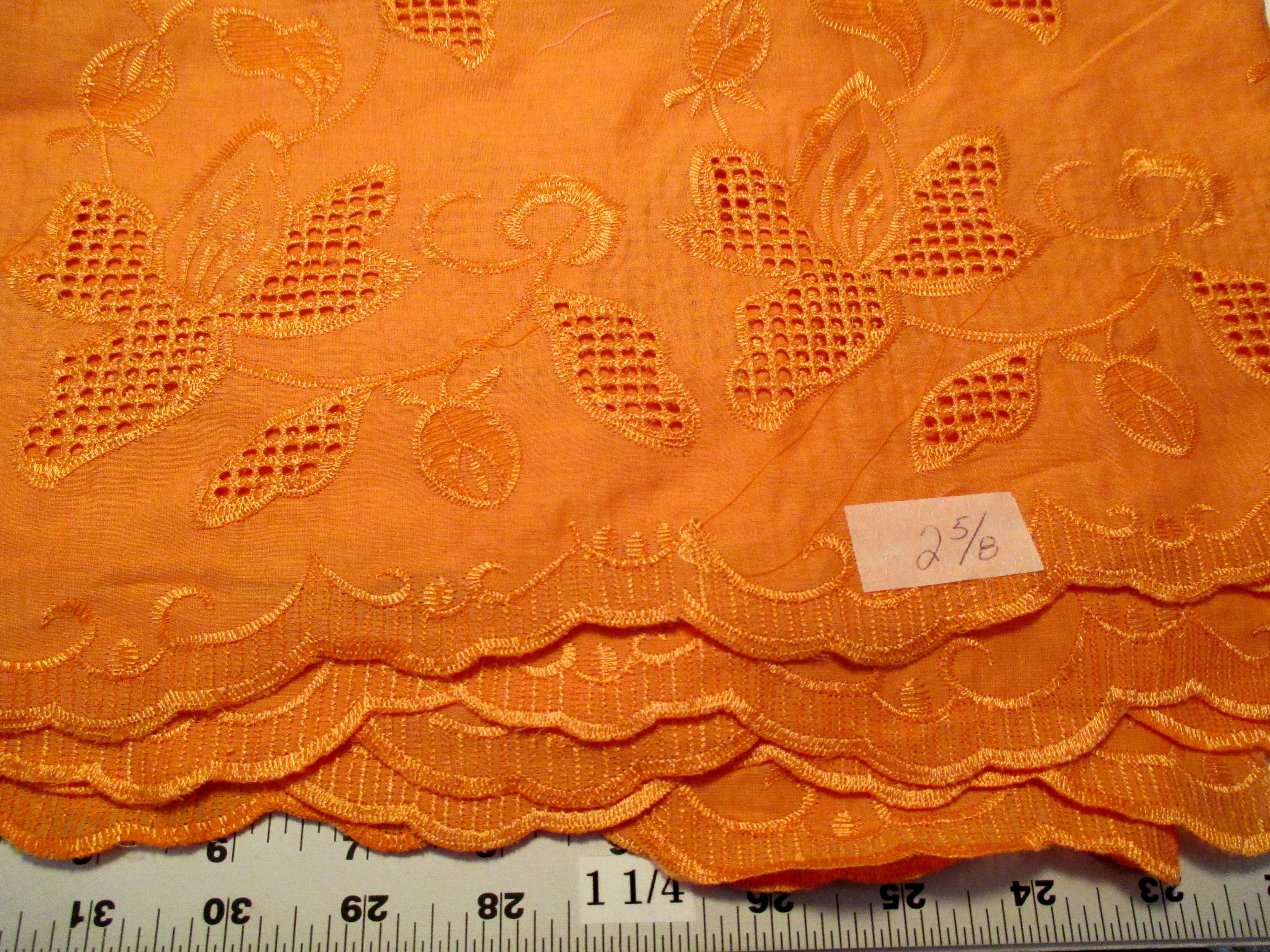 Tangerine eyelet cotton shirting